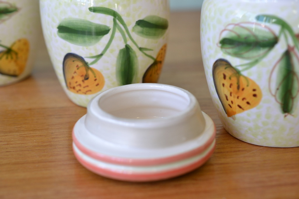 Vintage four Italian strawberry ceramic canisters