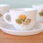 Vintage Milk glass tea cup and saucer with yellow flower