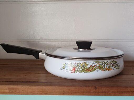 Vintage white enamelled saucepan vegetbles heavy metal